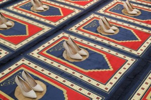 Zoulikha Bouabdellah, Silence, 2008-2014, Installation: 24 prayer rugs, 24 pair of shoes Courtesy: the artist © Zoulikha Bouabdellah
